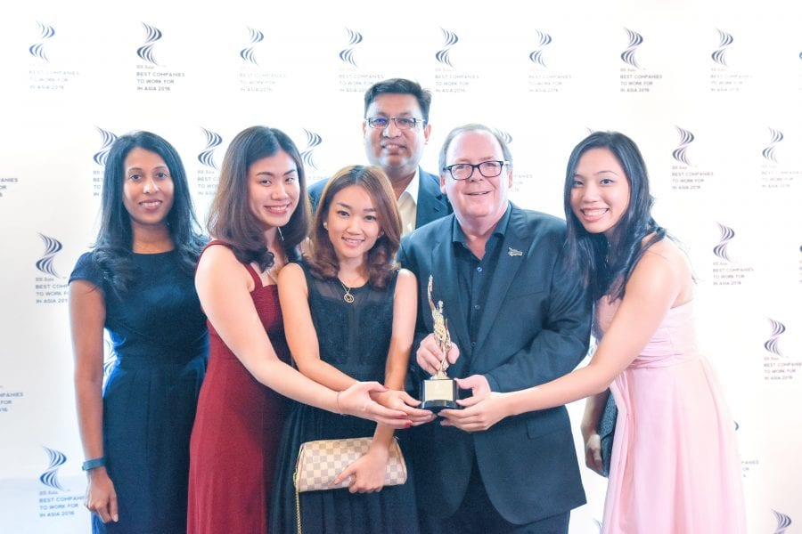 QI Malaysia employees all smiles with their much-deserved award