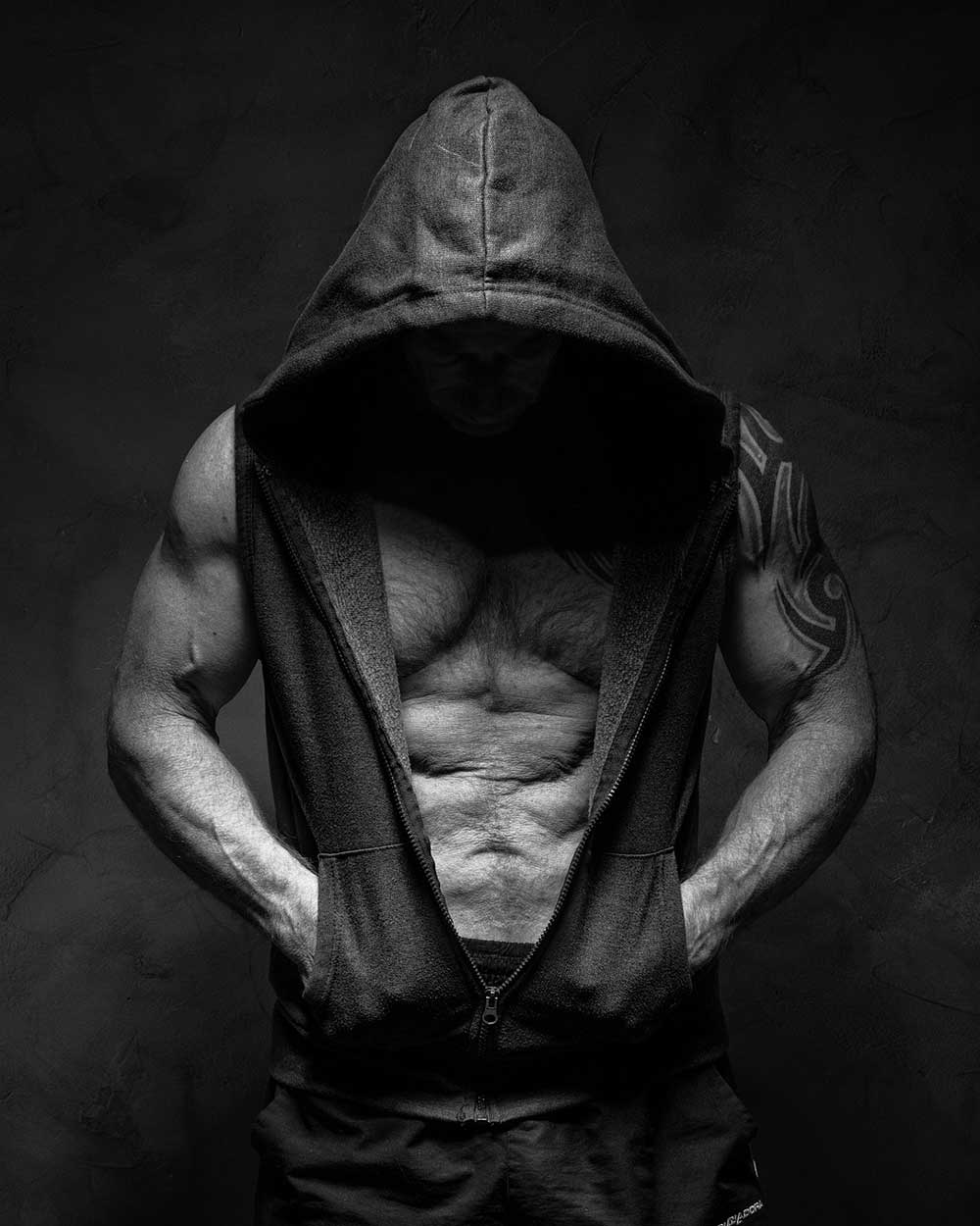 image of muscular man wearing hoodie testosterone q alive