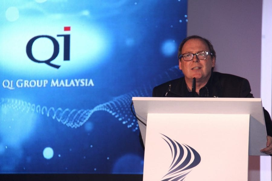 QI Group's Chief Human Resources Officer, Christopher Watson during his speech at the awards ceremony