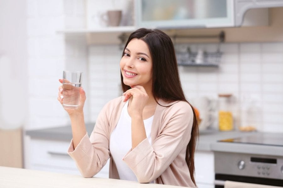 image of beautiful girl drink water benefits