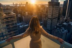 image of rich woman in a big city growth mindset success